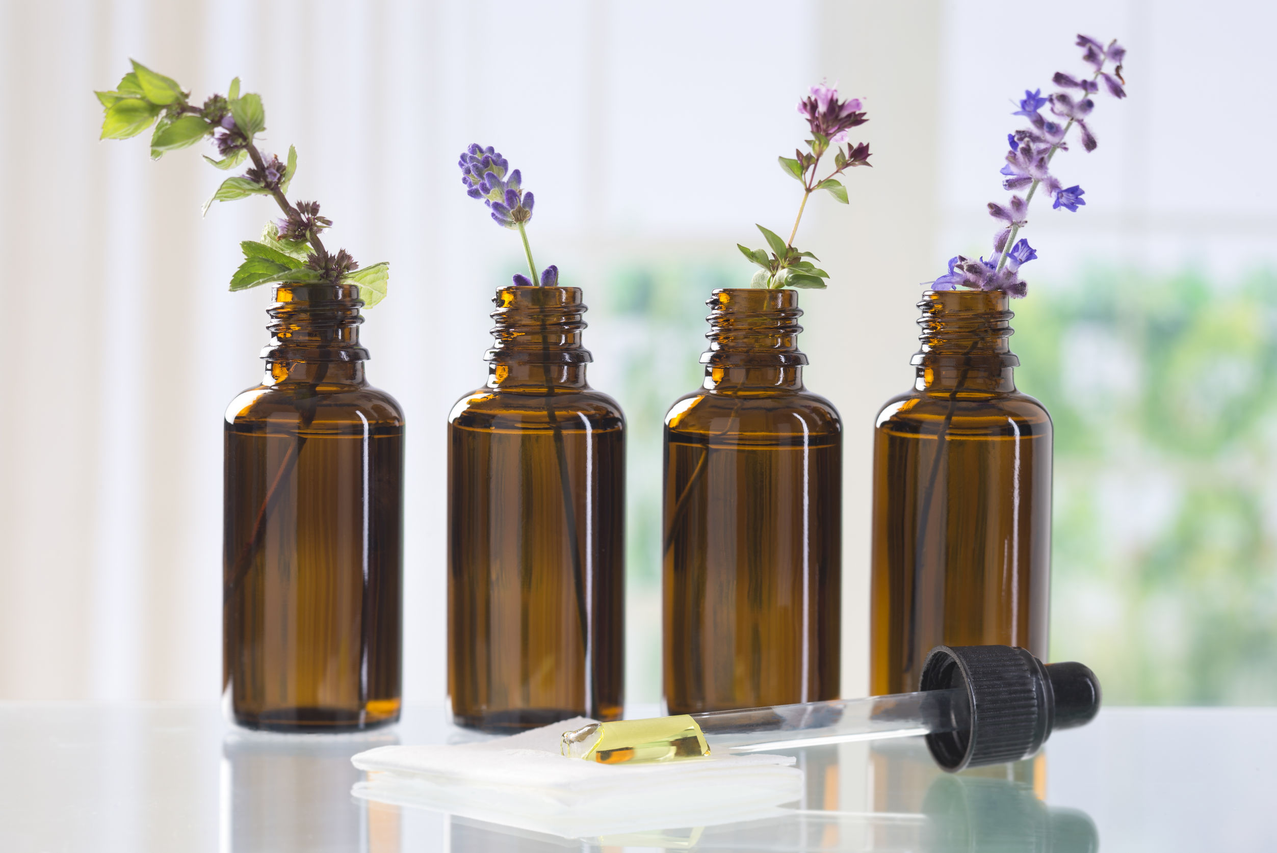45659456 - brown bottle  with aromatic herbs for essential oil